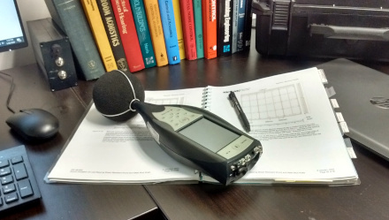 Sound level meter on desk