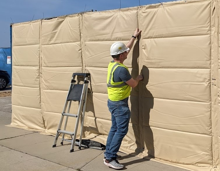 8 foot wall with worker